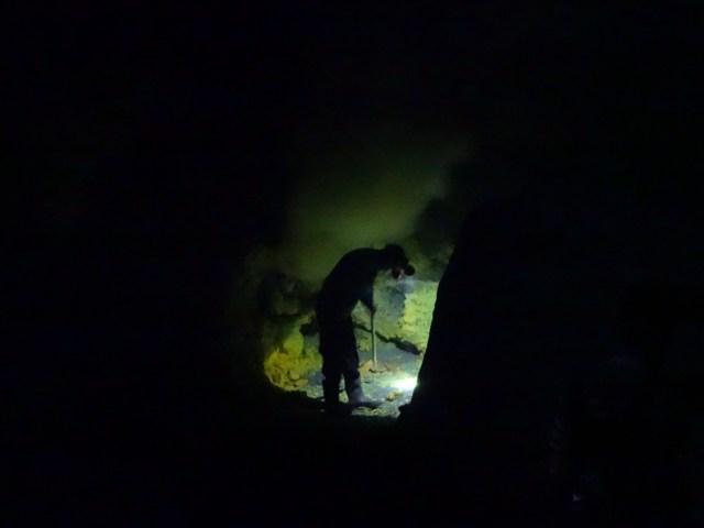 A sulphur miner in the dark.