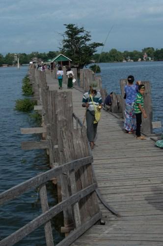 A fisherman on the teak bridge.