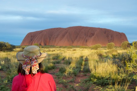 "Quintessential ""looking at Uluru in a hat"" photo."