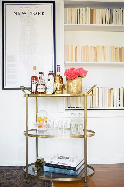 Gold circular bar cart with simple glass elements