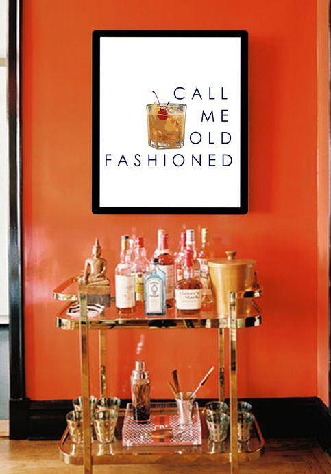 Shiny gold bar cart with warm orange and golden accents, with cocktail graphic on display