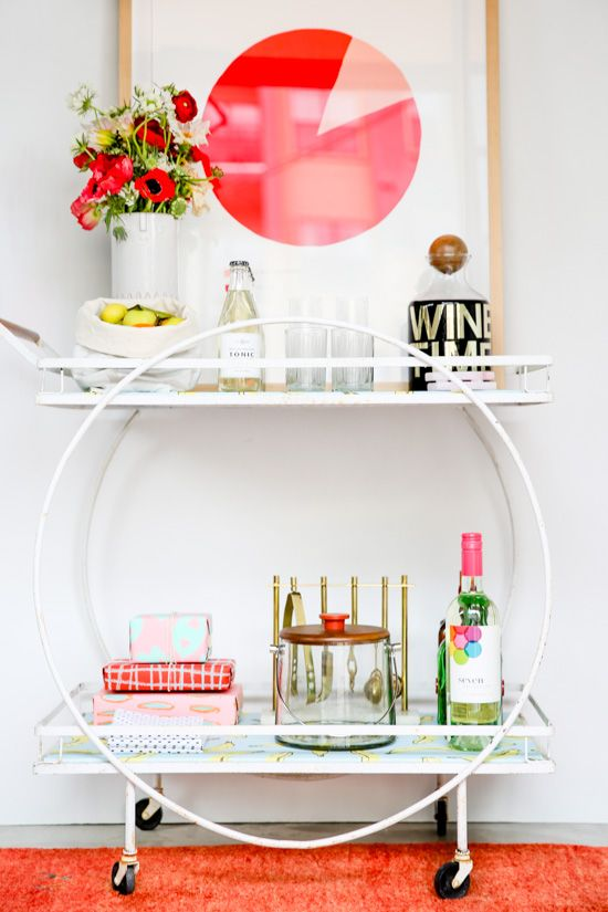 White bar cart with circle detail and pops of color