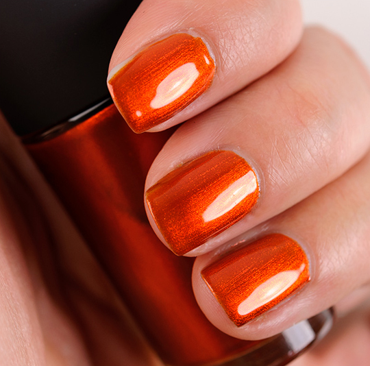 MAC Nail Lacquer in Styleseeker, a bright orange with shimmer