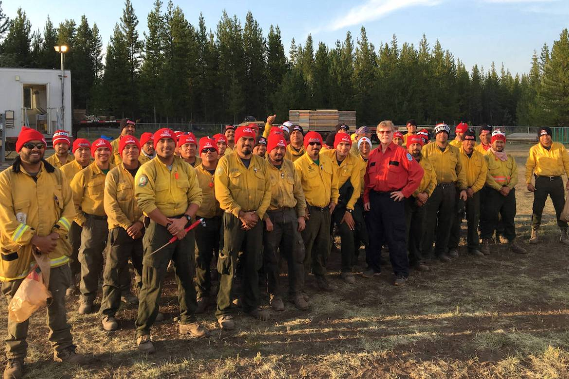 The Mexican firefighters wearing their Canada toques. (BC Wildfire Service)
