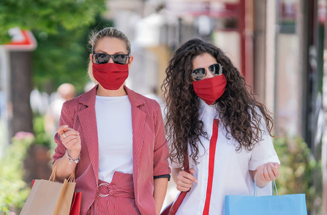 two women shopping wearing outfit coordinated face masks