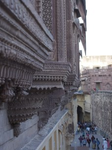 Huge facades of intricately carved red sandstone.