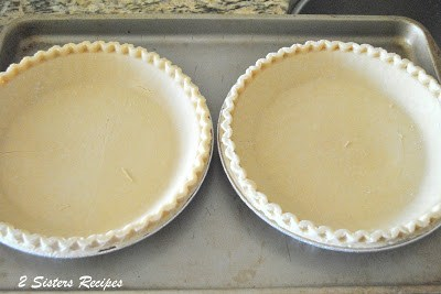 2 frozen pie crusts on a baking pan by 2sistersrecipes.com
