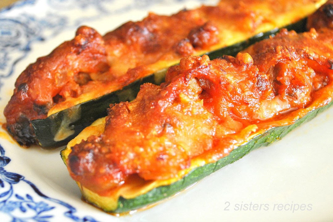 Zucchini Stuffed with Sausage Ragu and Cheese by 2sistersrecipes.com