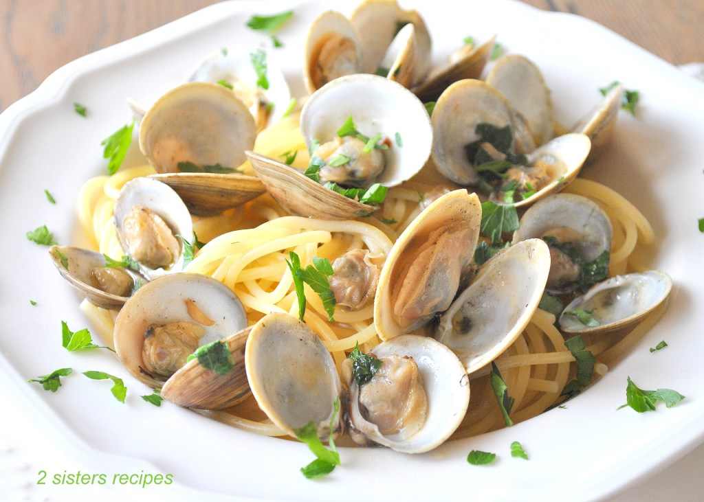 Little Neck Clams in Wine and Garlic Broth by 2sistersecipes.com