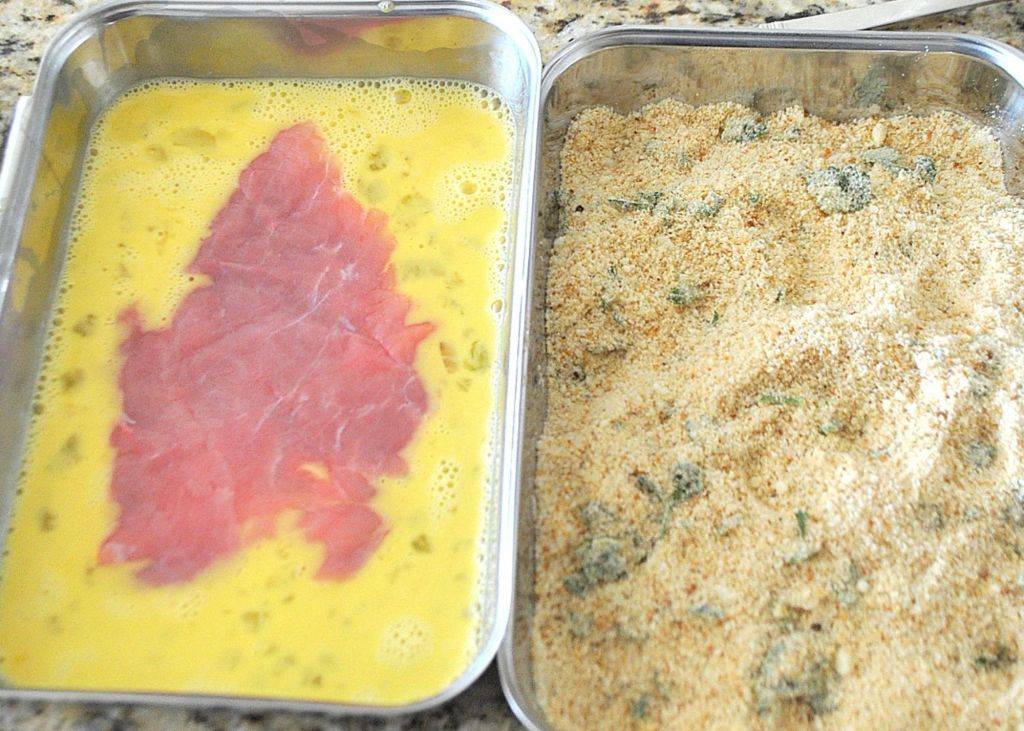 2 trays with veal in egg mixture and bread crumbs in the other. by 2sistersrecipes.com