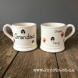 Penguin and robin fingerprint mugs