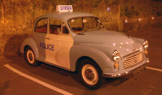 Old-style blue and white classic police car