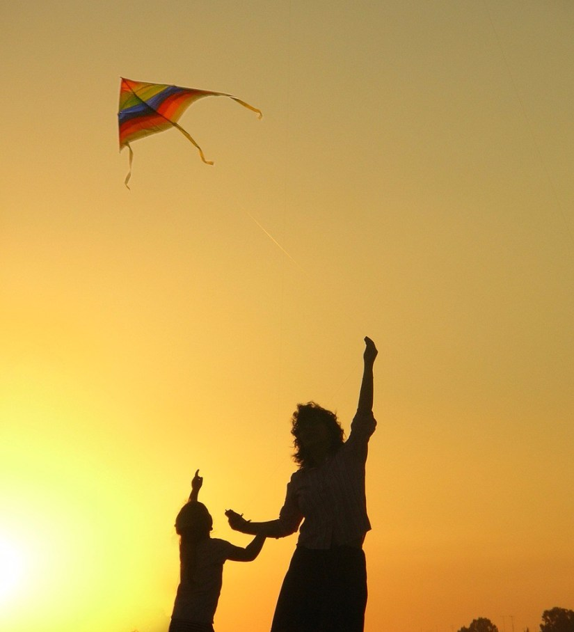 rainbow kite child mother