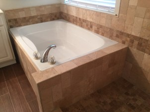 Carried decorative ban from shower around tub -- pencil trim along top