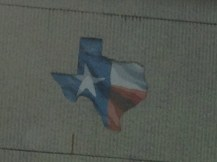 Texans are proud of Texas. This was on a freeway wall.