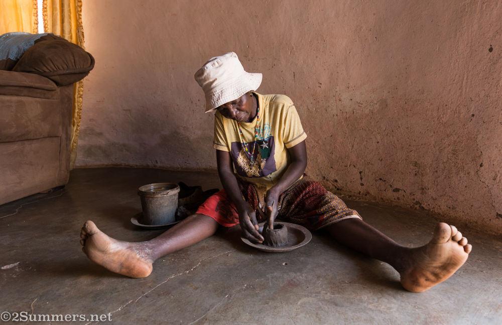 Esther making a pot