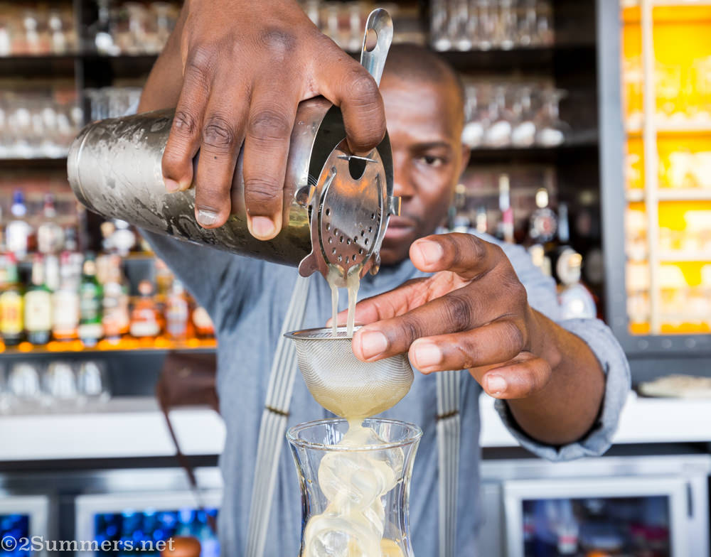 Thami makes a cocktail