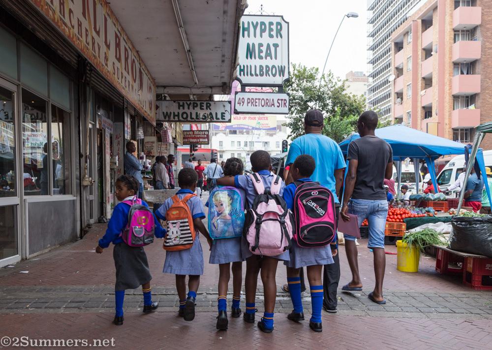 Kids walking home from school on Pretoria Street in Hillbrow