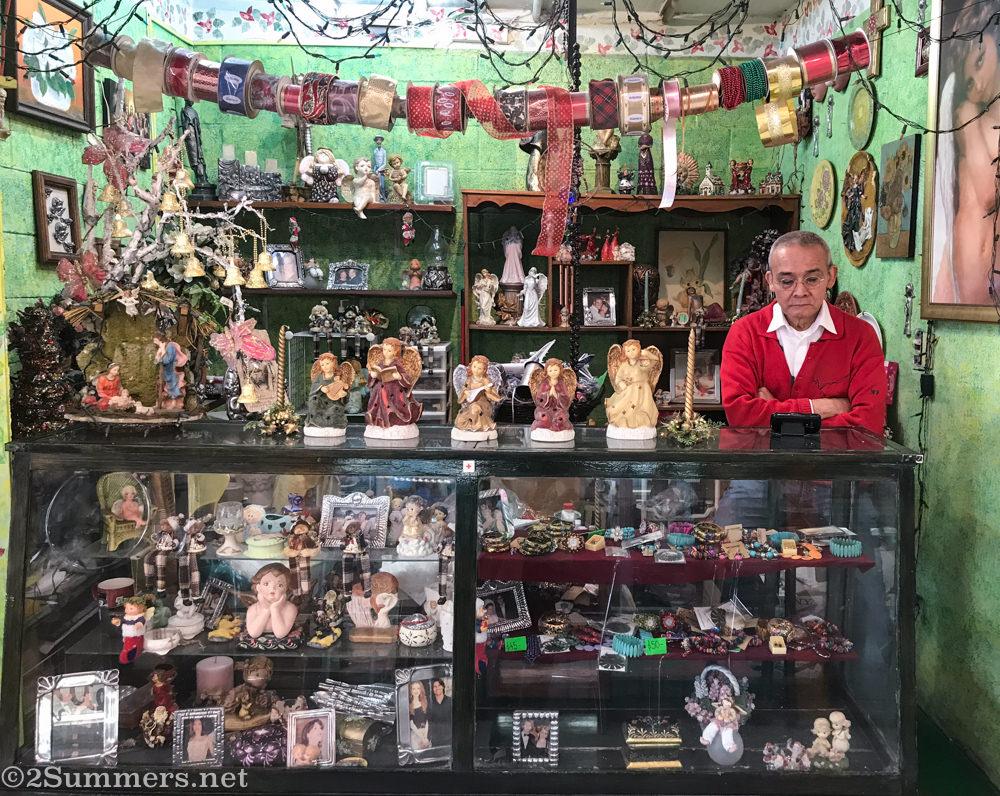 Angel salesman in Mercado Medellin