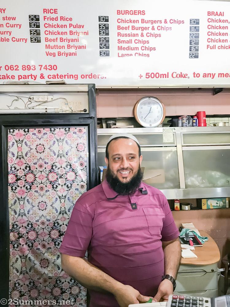 Man behind the counter at Food Junxion