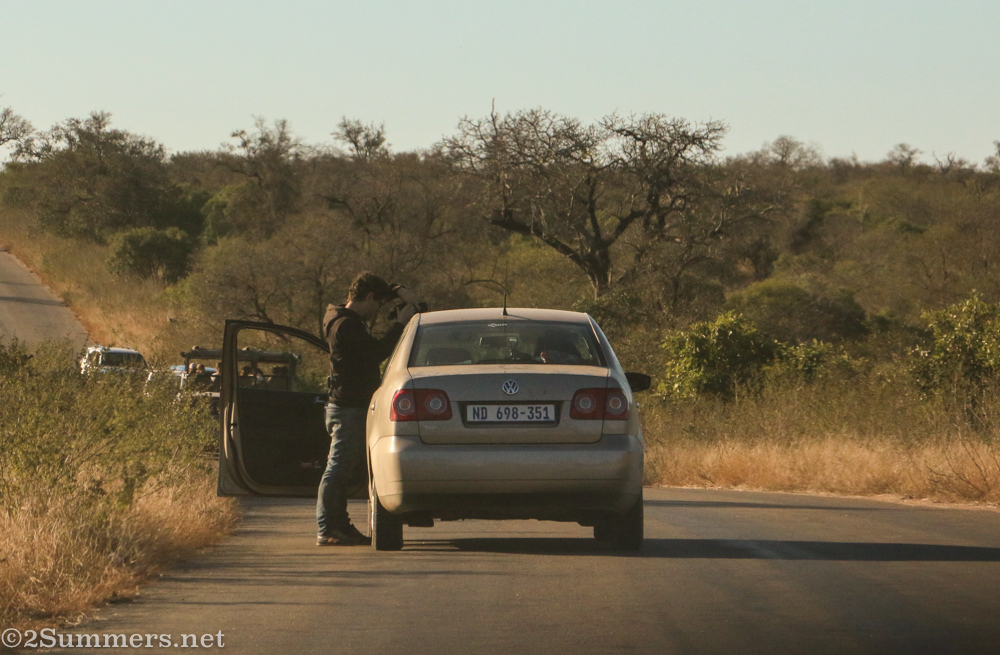 Guy outside his car in the Kruger