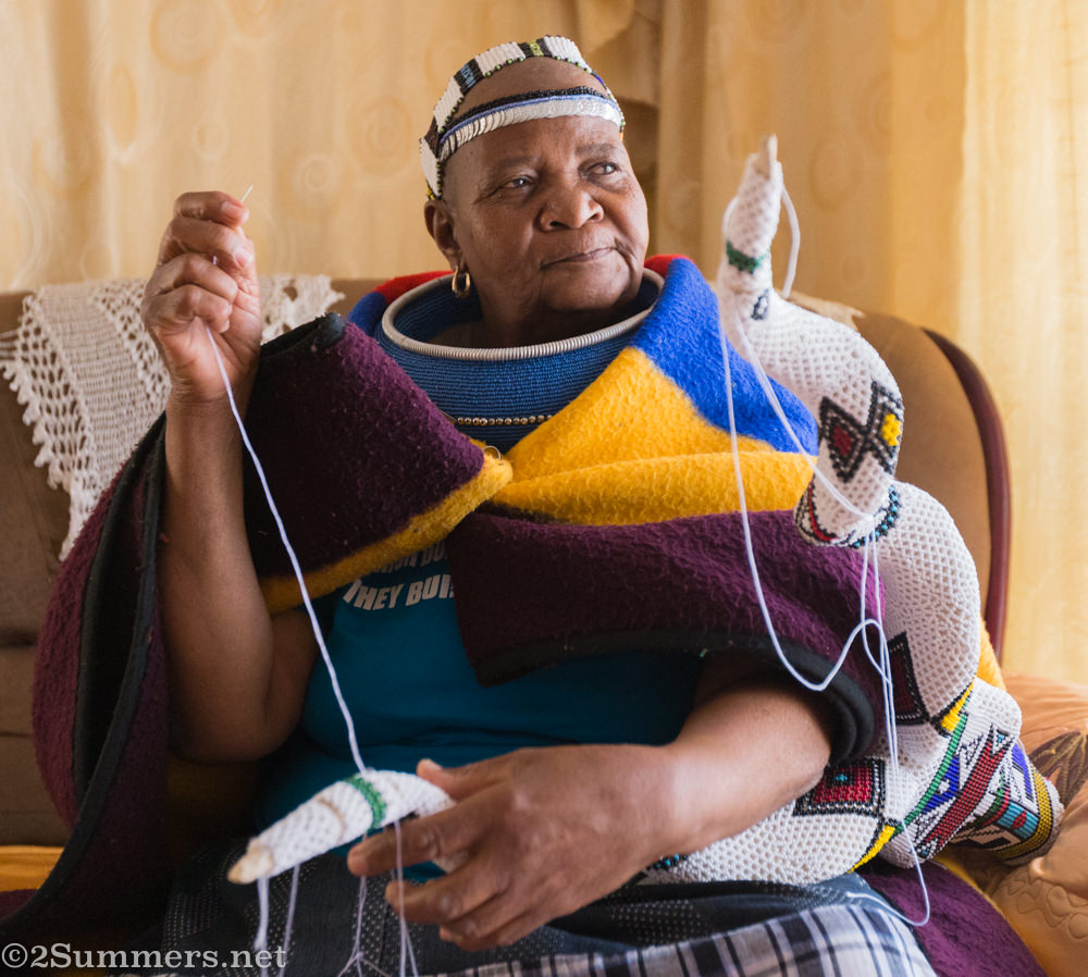 Mama Anna working on Ndebele art
