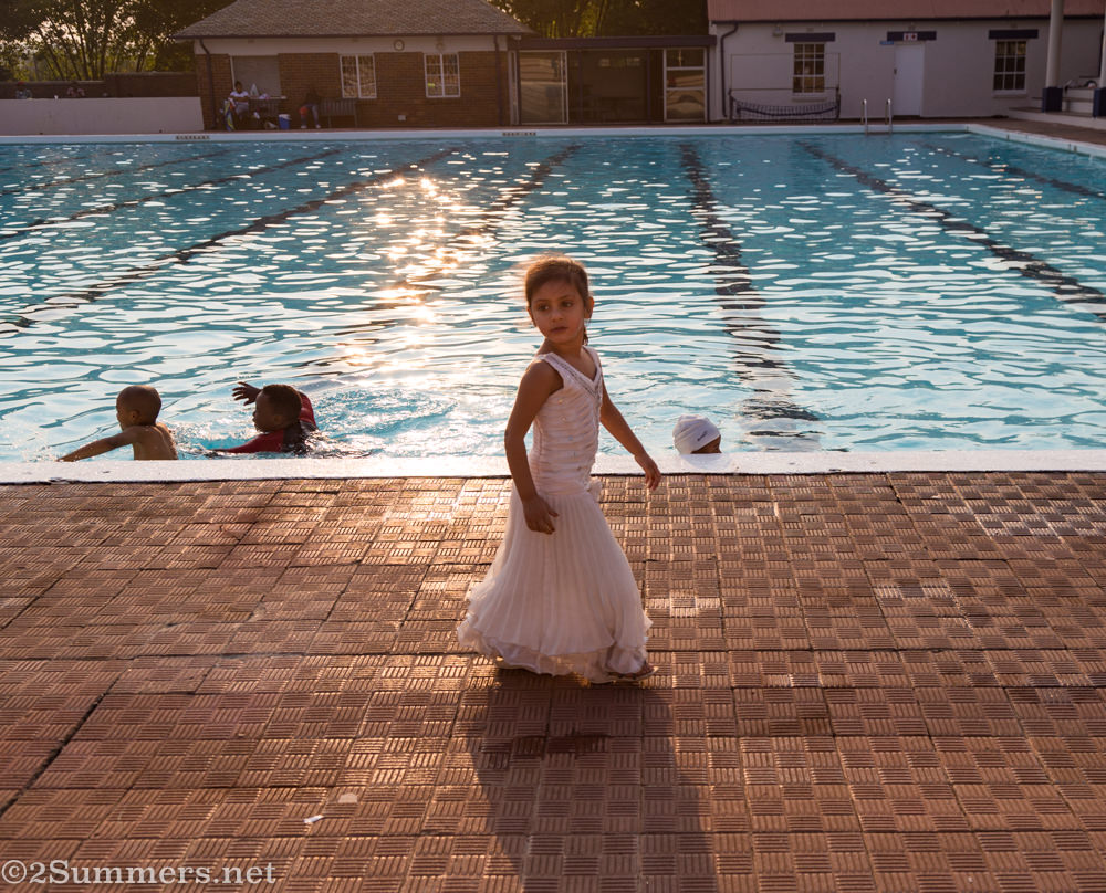 Little girl in a face dress at Zoo Lake Swimming Pool