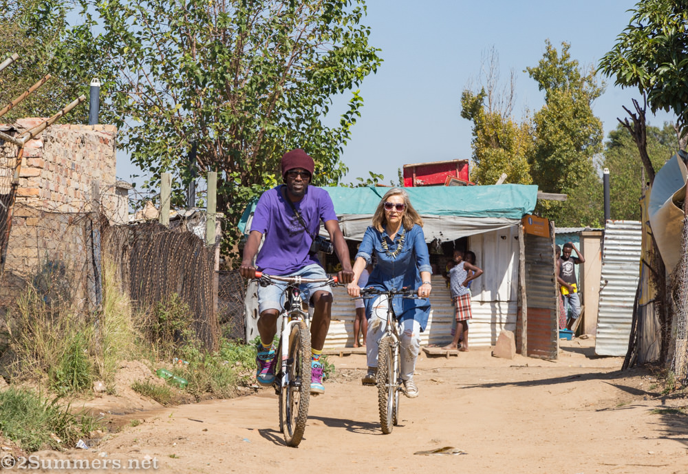 Marie-Lais and Lucky cycling through Diepsloot