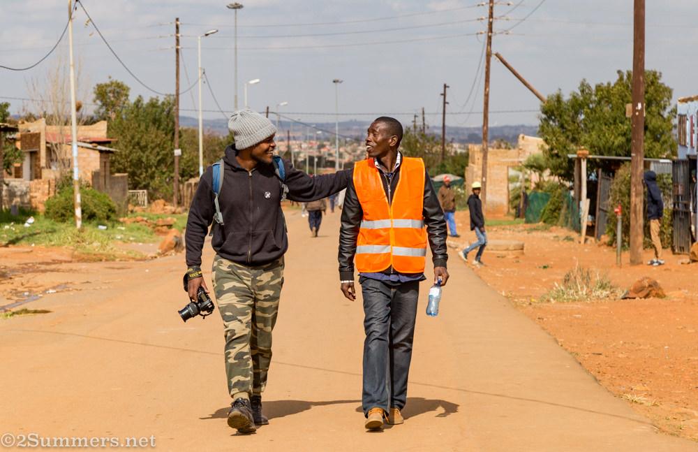 Photographer Hymie walks with Orange Farm host