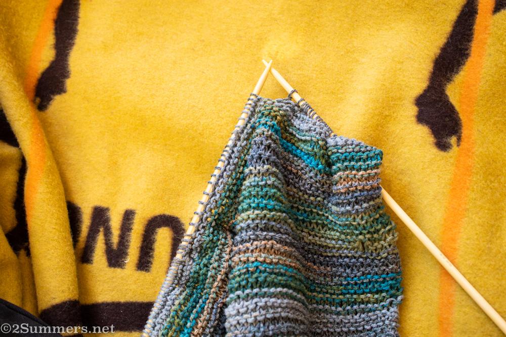 knitting on a Basotho blanket