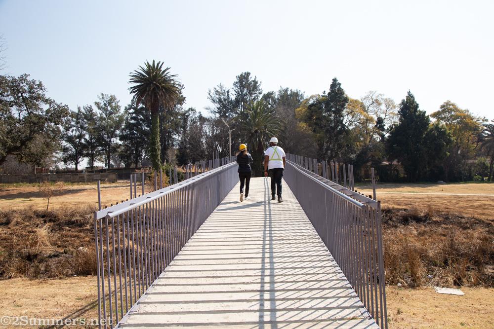 Walking across a bridge in Paterson Park