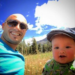 Rob Taylor and TinyMan picnic in field Yellowstone 1