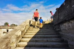 Chris Taylor and LittleMan climbing stairs at Castillo de San Marcos St Augustine 1