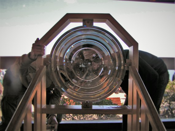 Chris and Rob Taylor behind Lighthouse Lens at Cabrillo National Monument San Diego 1