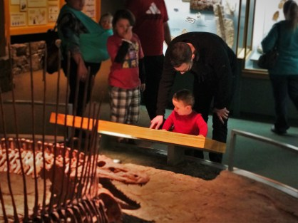 Chris Taylor and TinyMan with Dinosaur Skeletons in Denver Museum of Science and Nature 2