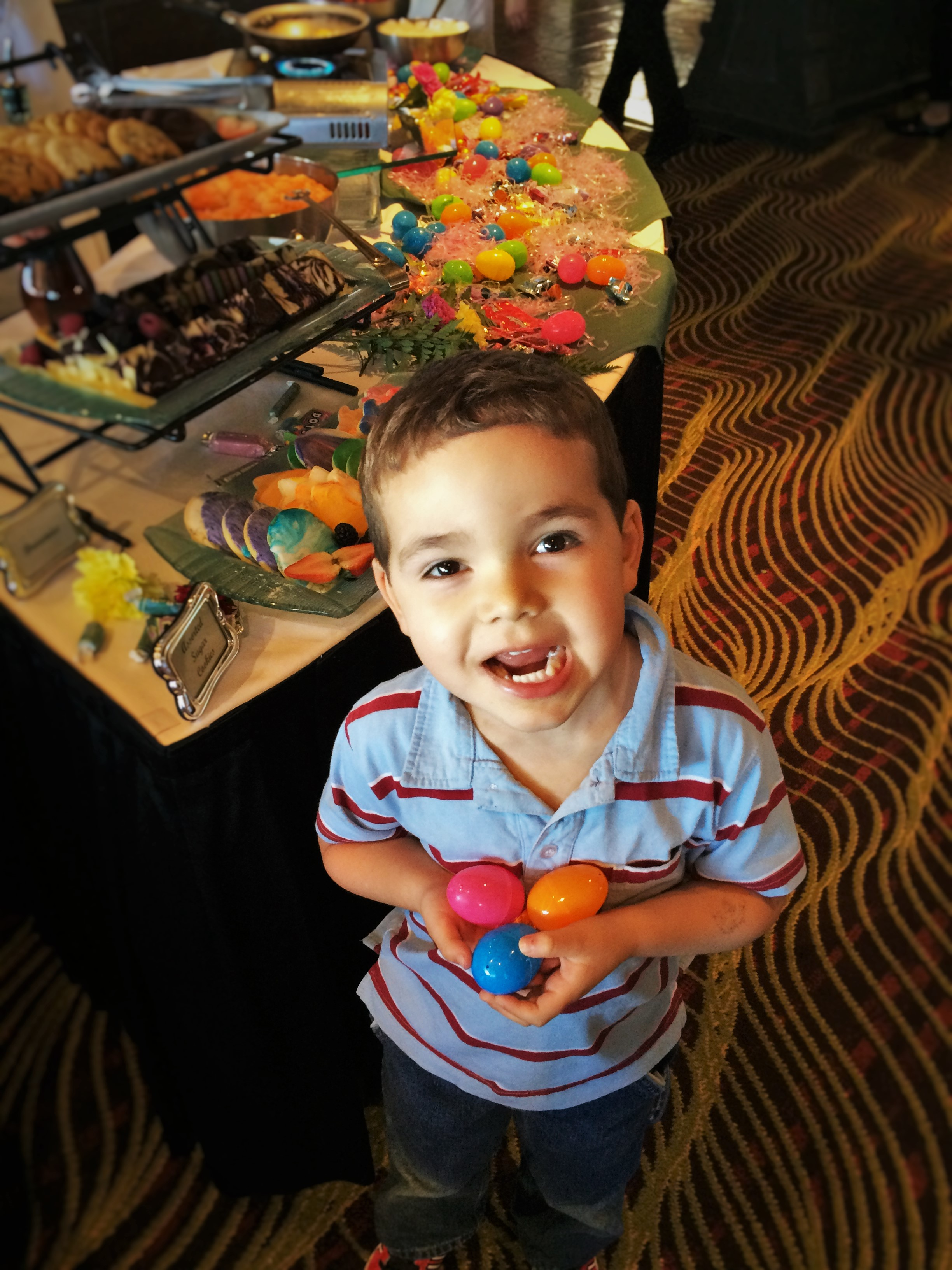 LittleMan with Easter eggs at brunch in Garden Terrace at Inverness Hotel Denver Colorado 1