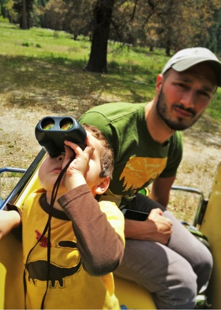 LittleMan and Rob Talor with binoculars on tram tour Yosemite National Park 2traveldads.com