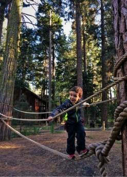 LittleMan on tightrope at Evergreen Lodge at Yosemite National Park 2traveldads.com