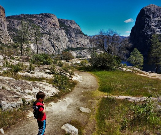 LittleMan with Piggyback Rider Granite peaks in Hetch Hetchy Yosemite National Park 2traveldads.com