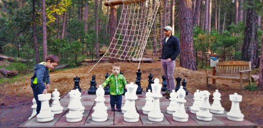 Rob Taylor and kids playing mega chess at Evergreen Lodge Yosemite 2traveldads.com