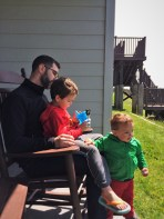 Chris Taylor and kids in rocking chair at Pacific Reef Hotel Gold Beach Southern Oregon Coast