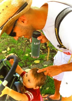 Rob Taylor and TinyMan in park using Stanley vacuum mug 2traveldads.com