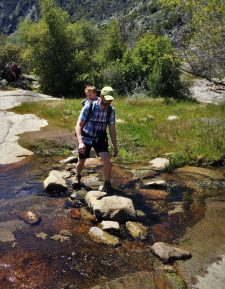Chris Taylor and TinyMan crossing creek at Hetch Hetchy Yosemite National Park 1