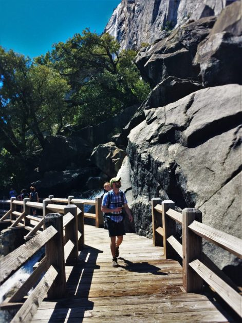Chris Taylor crossing footbridge at Hetch Hetchy Yosemite National Park 1