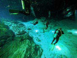 Divers Inside Mouth of Cenotes Dos Ojos Playa del Carmen Mexico 2