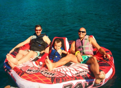 Chris and Rob Taylor with son inner tubing on Lake Cushman Olympic Peninsula 1