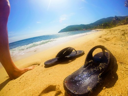 Flip flops on white sand beach in Labadee Haiti 2