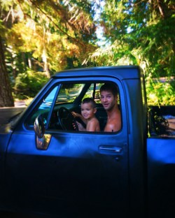 LittleMan and Uncle driving truck at Lake Cushman Family Reunion 1