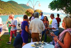 Pretty Fork Destination Dining guests with Oysters Rosario Resort Orcas Island