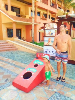 Playing Cornhole at Playa Grande while using a timeshare